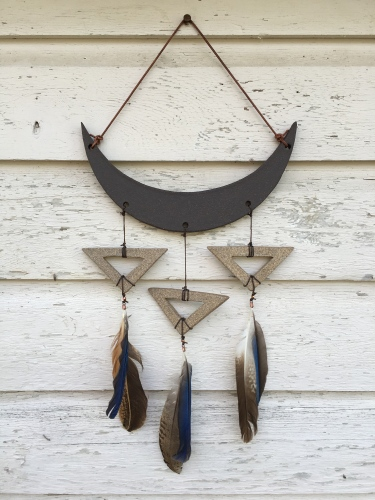 Moon wall hanging made with hand-cut cone 10 unglazed stoneware, with found feathers. $80