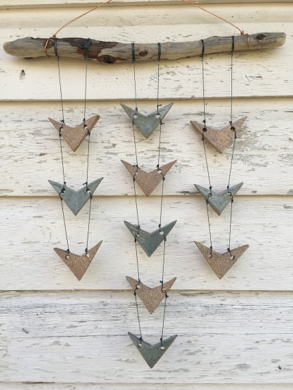 Wall hanging with hand-cut cone 10 stoneware tiles, mix of unglazed and celadon glazed, hung with driftwood and copper wire $80