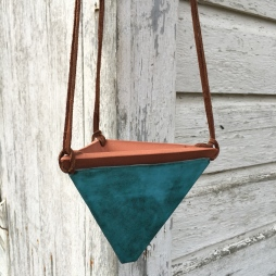 Hanging planter made with cone 6 stoneware. Matte turquoise glaze. Hung with suede lace. Drainage hole in bottom$45