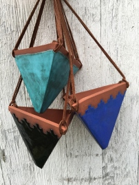 Hanging planter made with cone 6 stoneware. Turquoise matte, shiny black, and blue matte glazes shown. Hung with suede lace. Drainage hole in bottom $45 each