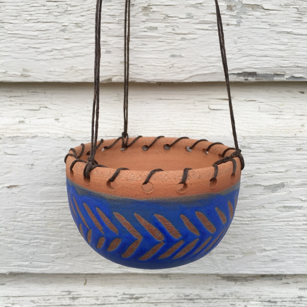 Hanging planter made with cone 6 stoneware. Blue matte glaze with hand-painted wax resist design. Drainage hole in bottom $30