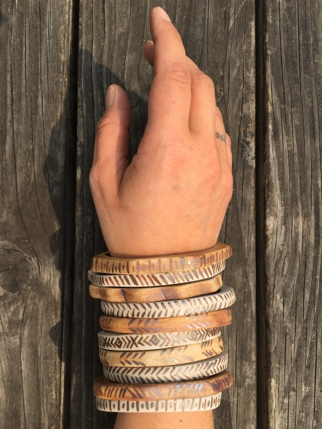 Bangles made with cone 10 stoneware. Hand painted designs with iron oxide $15 each