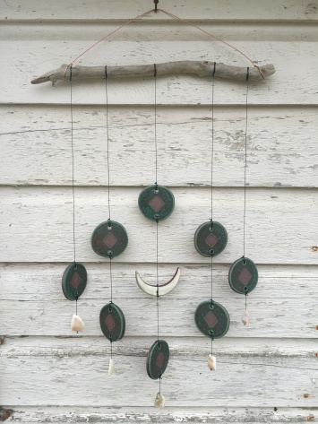 Wall hanging made with hand-cut cone 10 stoneware tiles. Hung on driftwood with shell accents $80