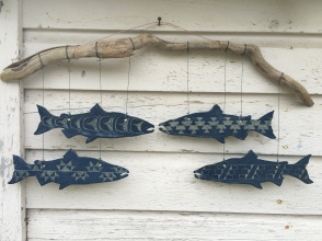 Wall hanging made with hand-cut cone 10 stoneware tiles with blue sgraffito designs. Hung on driftwood $300