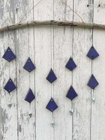 Wall hanging made with hand-cut cone 10 stoneware tiles, purple glaze, hung on driftwood $100