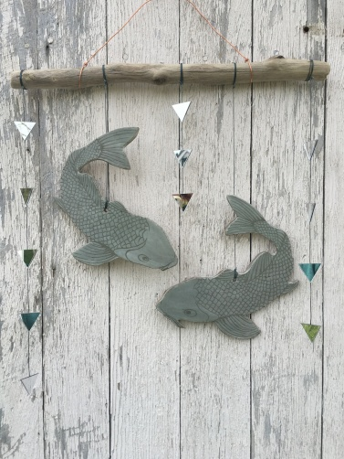 SOLD Koi wall hanging made with cone 10 stoneware, hand-carved sgraffito with clear glaze. Hung on driftwood with mirror accents