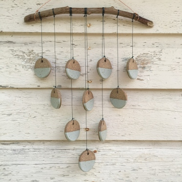 Wall hanging made with hand-cut cone 10 stoneware tiles, hung on driftwood $65