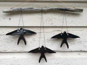 Swallow wall hanging made with hand-cut cone 10 stoneware tiles, hung on driftwood $45
