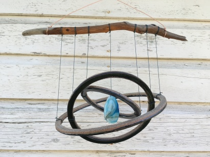 Mobile made with hand-cut cone 10 stoneware with black glaze. Hung on driftwood, with sliced agate pendant $110